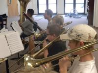 Middle school children playing trombone